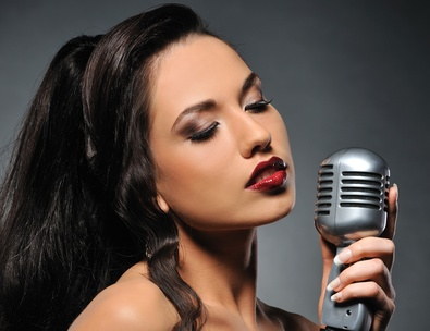 Beautiful brunette woman singing .